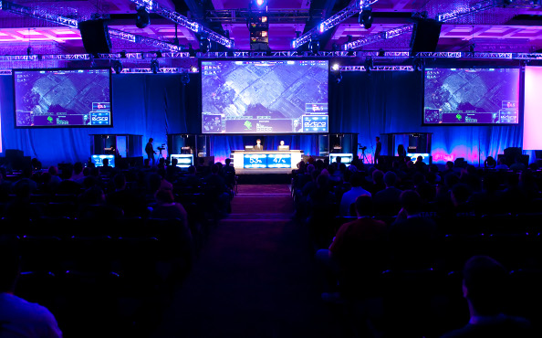 The main stage at IPL 5, viewed from the back of the room down the center aisle.