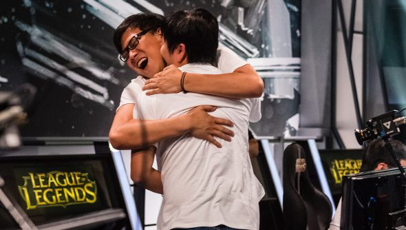 A pair of League of Legends pros celebrate their qualifying for 2014 Worlds.