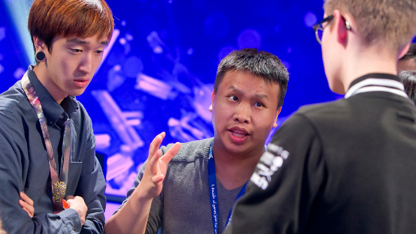 TSM Reginald confers with his staff and team between matches.