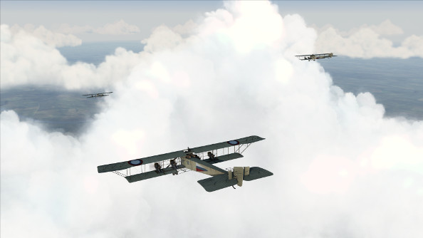 A trio of ungainly four-engine World War 1 bombers fly through the clouds.