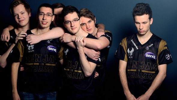 Five members of the Ninjas in Pyjamas team huddle happily to the left side in their black and gold jerseys, while a lone member stands sadly alone on the right, eyes downcast.