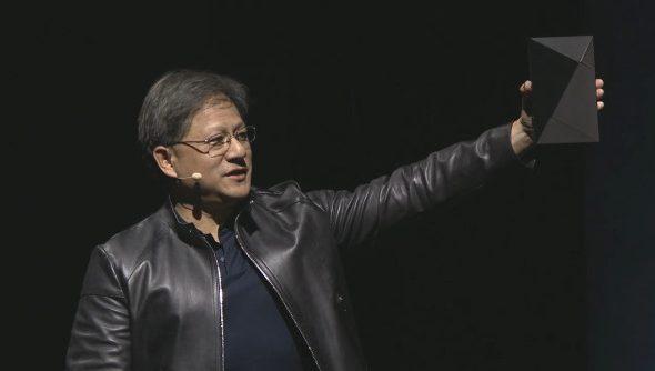 Nvidia President Huang raises the high-tech looking Nvidia Shield.