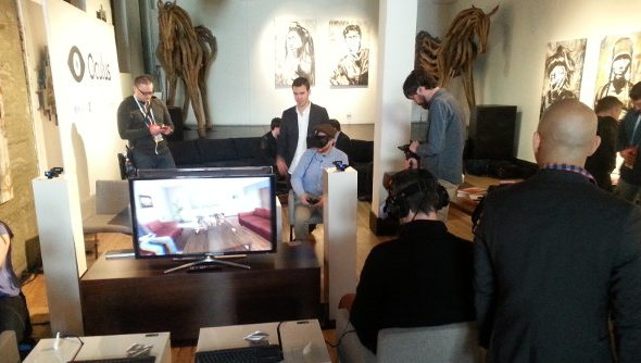 The Oculus demo station in San Francisco, set in a quiet gallery with expressionist art on the walls surrounding several demo areas.