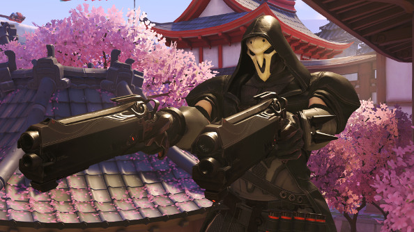 The death-like Reaper in Overwatch, with two giant black plasma pistols drawn.
