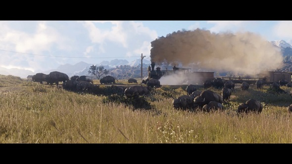 A steam train chugs past a herd of bison on a prairie