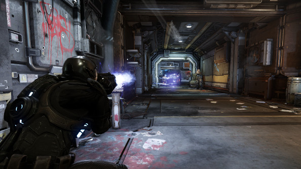 Armored space soldiers engage each other in a dim, metallic corridor illuminated by brilliant muzzle flashes.