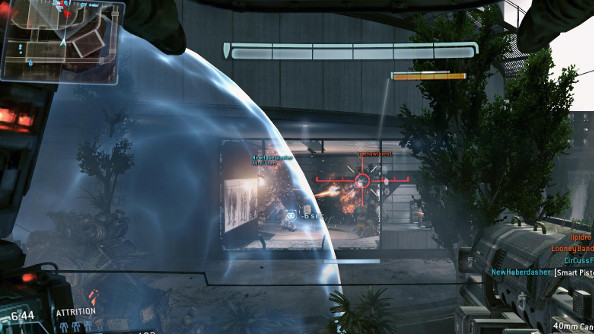 A Titan lands in front of the player's Titan as it puts flanking fire on an enemy inside a white glass-and-steel building.