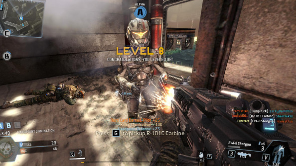 A metal-suited future solider stands still as an SMG fires directly into her chest at point-blank range in Titanfall. Several unlocks and bonuses appear on the screen.
