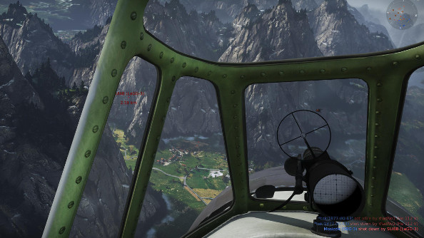 Diving into an Alpine valley, the view from a Japanese fighter catches an enemy fighter above green farm fields in the distance.