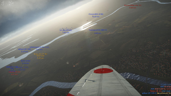 A high altitude view of a green-brown World War 2 battlefield, viewed over the wing of an aircraft.